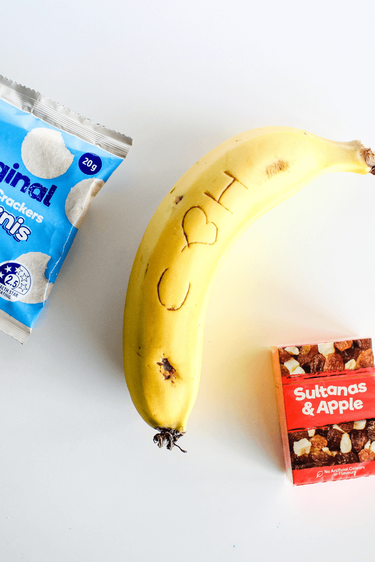 Writing messages on bananas with a toothpick is a great lunch box hack that is sure to make the kids smile.
