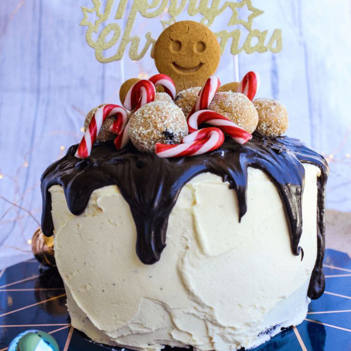 This Christmas cake is a cute way to dress up Woolworths mud cakes.  You can really get as creative as you want, but I kept it simple by covering the cakes in vanilla buttercream icing, topping with dark chocolate ganache and topping with a gingerbread man, some mini candy canes and Woolworths White Rum Balls.