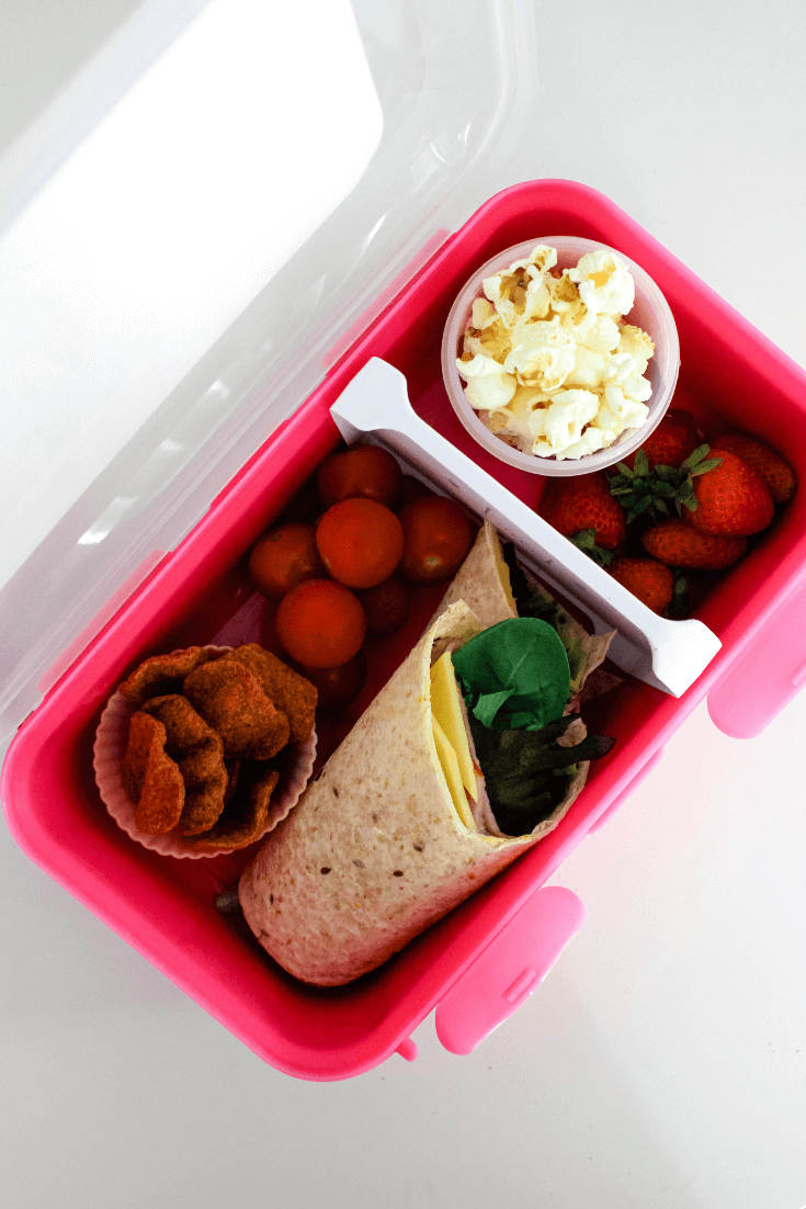 This lunch box was packed with the help of my daughter.  It starts with a multigrain wrap filled with ham, cheese, lettuce leaves and carrot as her lunch item.