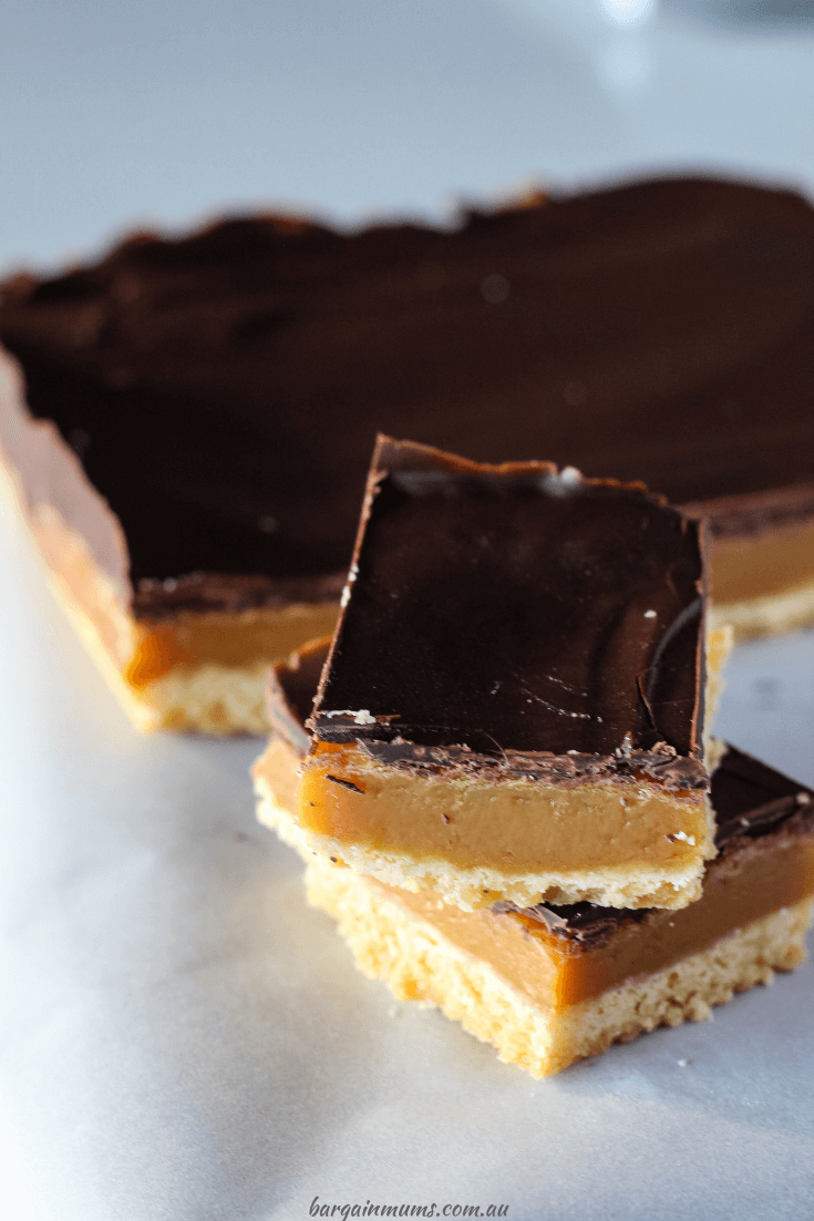 This Caramel Slice is seriously addictive. Starting with a biscuit base, topped with soft caramel and dark chocolate.