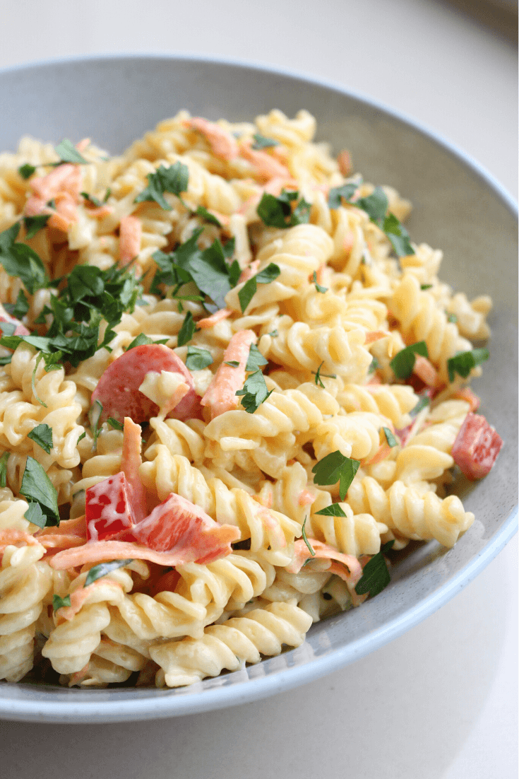 This creamy pasta salad is sure to be a hit with the family.  It tastes just like the pasta salad you buy pre-done from the supermarket, and is so quick and easy to put together.