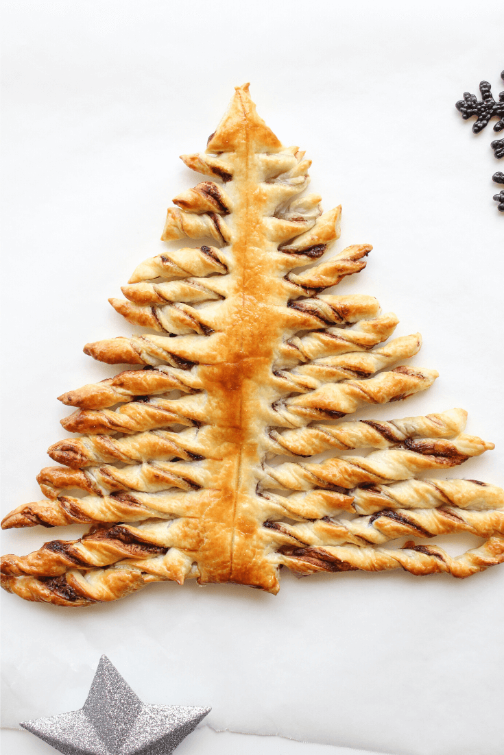 This cute Nutella Christmas Tree is make with sheets of puff pastry sandwiched together with Nutella. It's the perfect quick and easy Christas treat that the whole family will love.