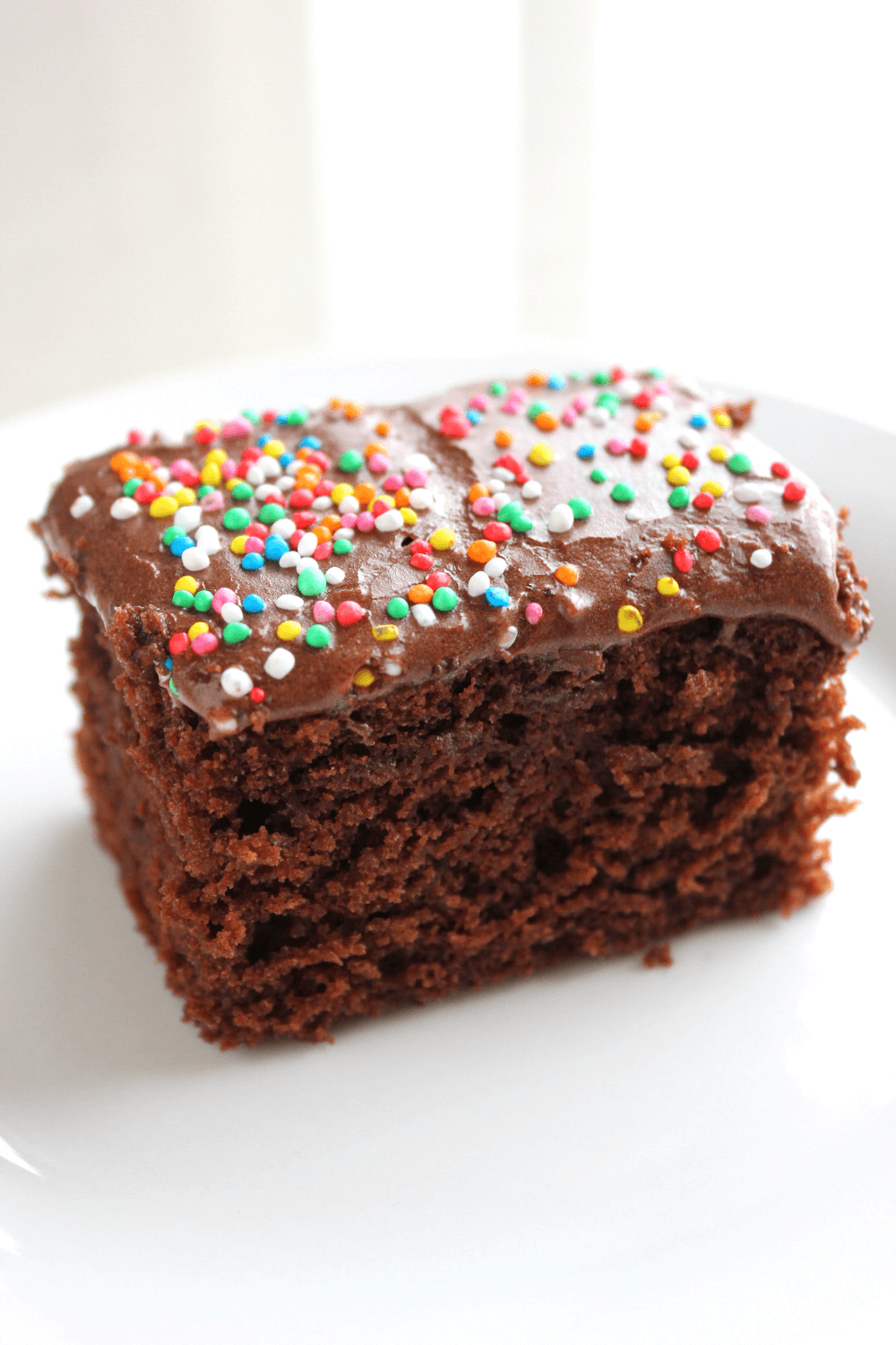 This chocolate crazy cake, or depression cake or wacky cake as it is sometimes known, contains no eggs, butter or milk.  This cake only uses basic pantry staple ingredients, perfect for those times you have no eggs or butter on hand.