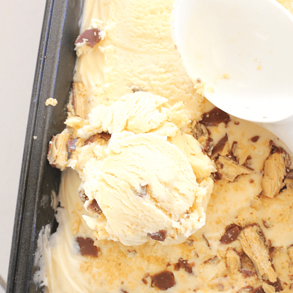 This no churn Caramilk ice cream is amazing.  It's so quick and easy to make, and only requires 4 ingredients.  It's the perfect frozen Caramilk dessert.
