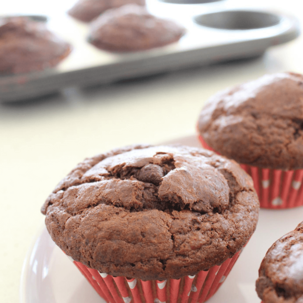 These chocolate banana muffins are amazing!  The added banana makes these muffins perfectly soft, and the added chocolate chips give amazing hits of chocolate as you eat them.