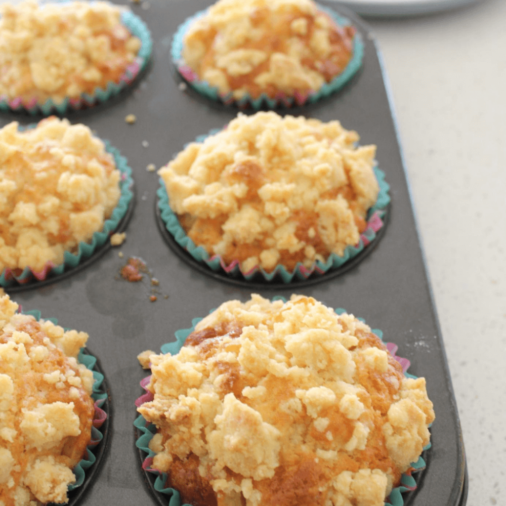 These apple crumble muffins just just like apple crumble, but in the form of a muffin!  They start with a deliciously soft muffin made using my basic muffin recipe, which is packed full with pieces of apple.  They are then topped with a sweet and crispy crumble topping.  It's impossible to stop at just one of these muffins.
