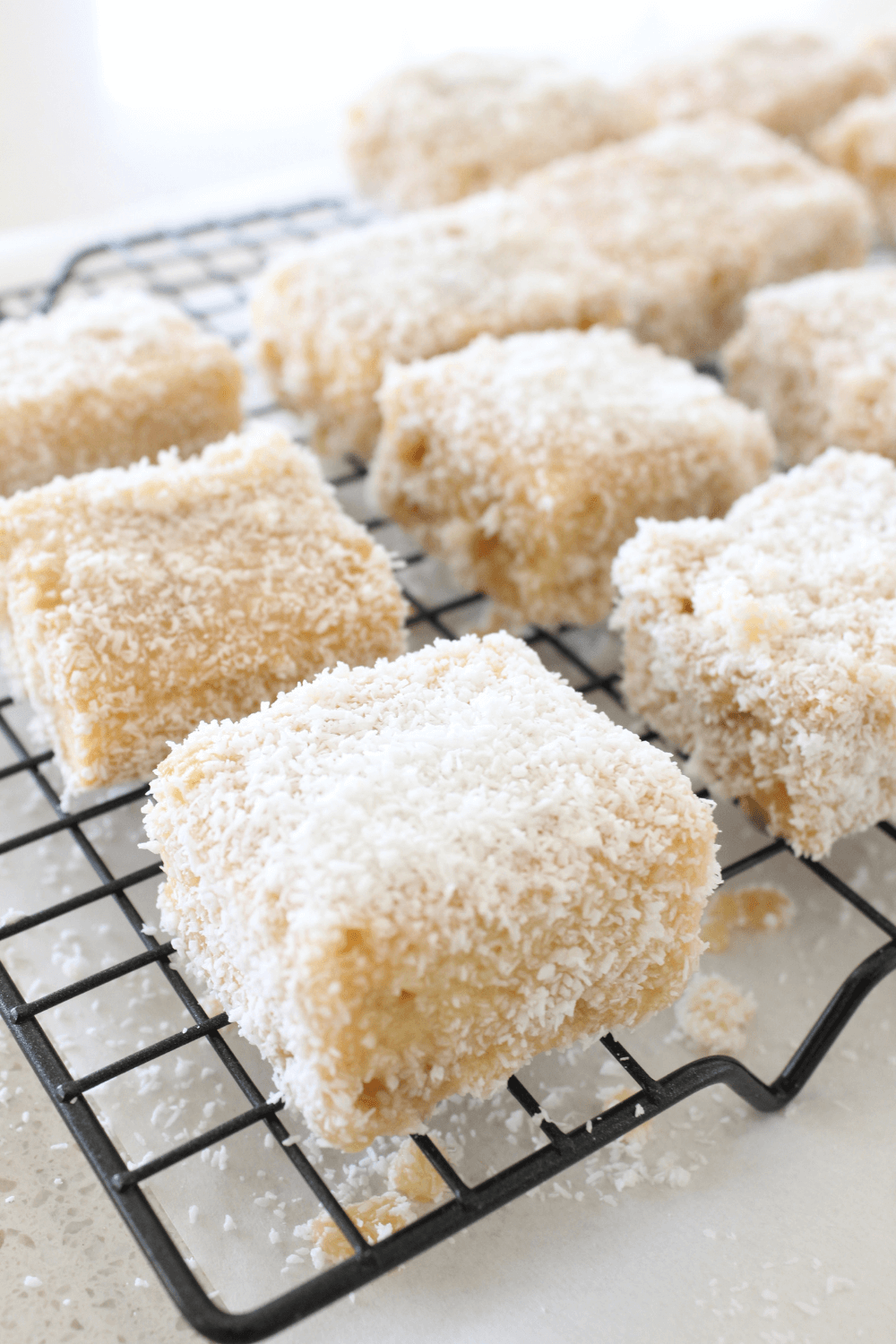 These Caramilk lamingtons are a twist on the favourite Australian dessert. For those not familiar with lamingtons, they are basically a sponge cake cut into pieces, dipped in chocolate icing and coated in desiccated coconut.