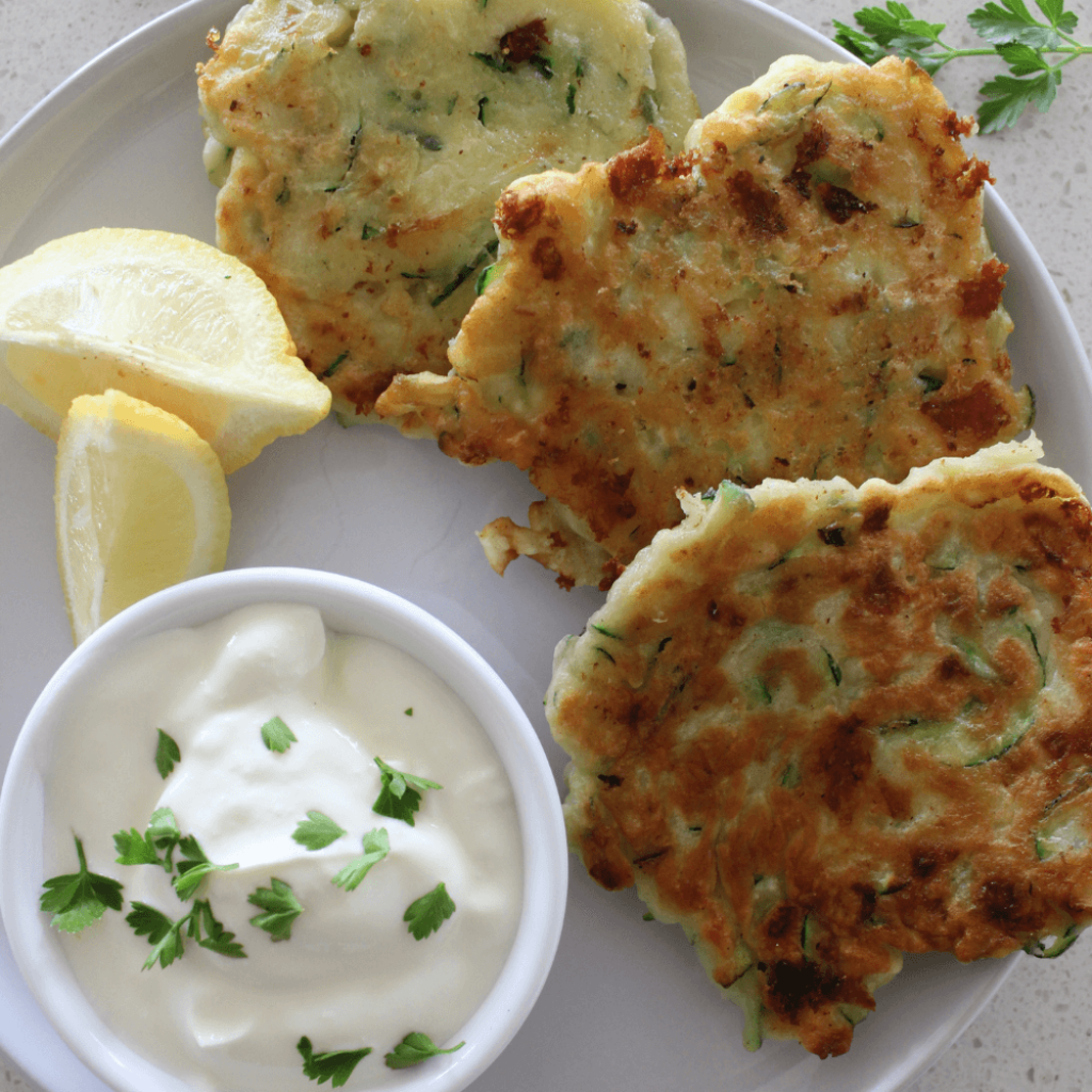 Fritters are one of my favourite lunch or light dinner options, and these cheesy zucchini fritters are no exception.  The addition of grated cheese to the batter makes for one delicious fritter recipe.