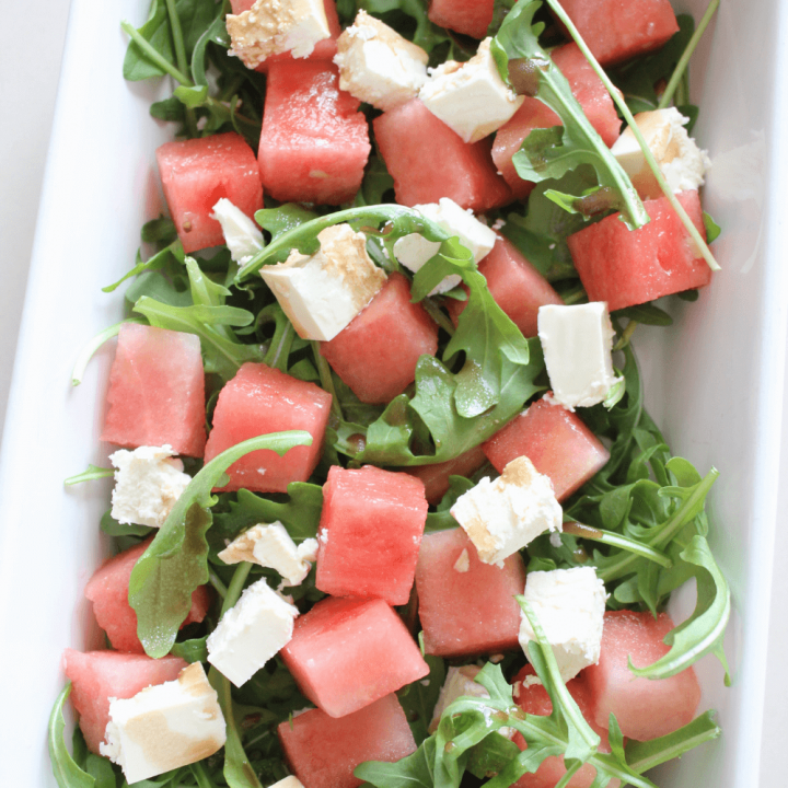 This watermelon and rocket salad is the ultimate summer salad. With juicy watermelon, creamy feta and peppery rocket, it's the perfect salad to accompany any summer BBQ.