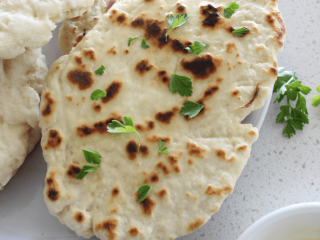 This is the easiest naan bread recipe around. You only need 2 simple ingredients, and no proving of dough is required!
